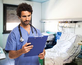 Medical worker reading document — Stock Photo