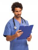 Doctor reading document — Stock Photo