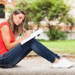 Woman studying outdoors — Stock Photo #63969395