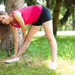 Woman stretching her legs — Stock Photo #65081099