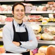 Shopkeeper in grocery store — Stock Photo #65669917