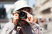 Tourist using his camera — Stock Photo
