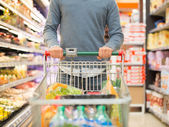 Person shopping in a supermarket — Stock Photo