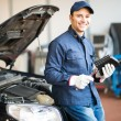 Mechanic holding jug of motor oil — Stock Photo #67061651