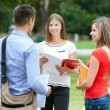 Young students talking outdoors — Stock Photo #67068051