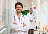 Smiling doctors in an hospital — Stock Photo