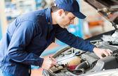 Mechanic at work in garage — Stock Photo