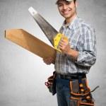 Carpenter holding wood planks — Stock Photo #68240289