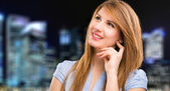Beautiful businesswoman looking up — Stock Photo