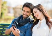 Man showing his phone to girl — Stock Photo