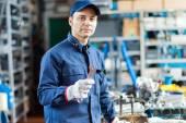 Auto mechanic holding wrench — Stock Photo