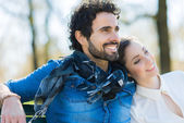 Couple relaxing on bench — Stock Photo