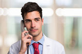 Doctor talking on the phone — Stock Photo
