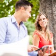 Students studying in a park — Stock Photo #71381627