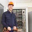 Technician in front of a network rack — Stock Photo #71382101