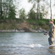 Fisherman fishing in a river — Stock Photo #71382147