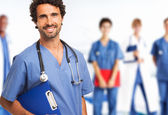 Doctor in front of his medical team — Stock Photo
