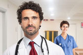 Handsome doctor and nurse — Stock Photo