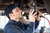 Mechanic repairing a car — Stock Photo