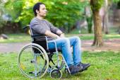 Paralyzed man using his wheelchair — Stock Photo