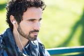 Man listening music outdoors — Stock Photo