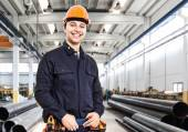 Engineer smiling in factory — Stock Photo