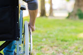 Man using a wheelchair in park — Stock Photo