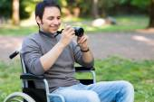 Paralyzed man taking picture — Stock Photo
