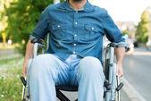 Man using a wheelchair in an urban street — Stock Photo