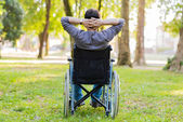 Man sitting in wheelchair — Stock Photo
