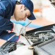 Mechanic working in garage — Stock Photo #72032719