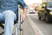 Detail of a man using a wheelchair — Stock Photo