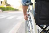 Man in wheelchair preparing to go across the road — Stock Photo
