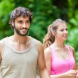 Couple running in a park — Stock Photo #72586763
