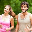 Couple running in a park — Stock Photo #72586769