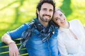 Couple on the bench outdoors — Stock Photo