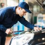 Mechanic at work in his garage — Stock Photo #73028021