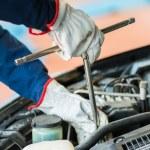 Mechanic repairing a car — Stock Photo #73028081