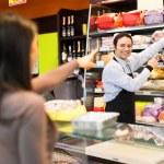Shopkeeper serving customer — Stock Photo #73029077