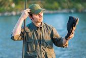 Fisherman caught shoe in river — Stock Photo