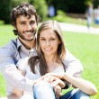 Smiling couple relaxing outdoors — Stock Photo #74707935