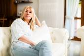 Woman relaxing on couch — Stock Photo