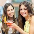 Two friends drinking a cocktail — Stock Photo #75388717