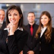 Businesswoman in front of her colleagues — Stock Photo #75388761
