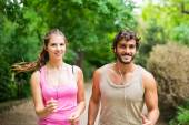 Couple running in a park — Stock Photo