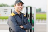 Smiling worker at gas station — Stock Photo