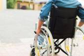 Disabled man trying to getting on a ramp — Stock Photo