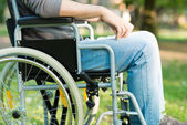 Disabled man using tablet in a park — Stock Photo