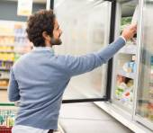 Man taking deep frozen food from freezer — Stock Photo