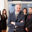 Leader in front of his team — Stock Photo #75998763